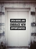 Motivational And Inspirational Quotes - Open Doors And Embrace New Opportunities. With Blurred Vinta poster