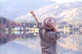 Girl Stands On The Shore Of A Mountain Lake poster
