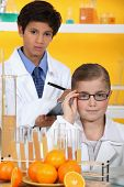 Children analysing orange juice