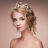 Young Blonde Woman With Tiara On Her Head. Blonde Girl With Elegant And Shiny Hairstyle. Beautiful M poster
