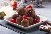 Christmas Sweet Candies On The Dessert Table . Chocolate Balls Of Biscuit With Cherry - Loli Pop Or  poster
