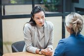 Job Interview Or Business Meeting Face - To-face. Two Business Women At A Meeting. Recruiter And The poster