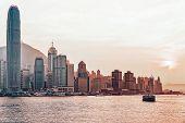 Star Ferry At Victoria Harbor In Hong Kong At Sundown poster