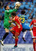 BARCELONA - 28, APRIL: Juan Pablo Colinas(L) of Gijon block the ball between Damian(C) and Coutinho(