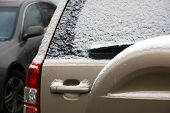 Back View Of Car Covered With First Snow. Slippery Roads, Dangerous Weather For Driving. poster