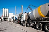 Concrete mixing trucks on an industrial site