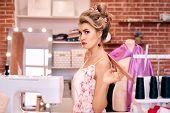 Blonde Girl Seamstress With Creative Hairdo Studio poster