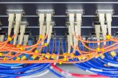 Cable Network , Fiber Optic Cable Connect To Switch Port In Server Room , Concept Network Management poster