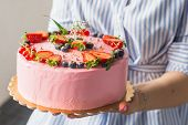 Homemade Pink Birthday Cake Decorated With Strawberries, Blueberries, Red Currant And Flowers. Food  poster