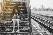 Depressed Young Asian Woman Sitting On Overpass Near Railway At Train Station,nagative Attitude,suic poster