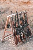Carabiners And Rifles At The Shooting Range. Concept For Shooting School, Shooting Courses And Safe  poster