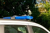 Blue Warning Lightbar On A Police Or Emergency Car. Roof Mounted Lightbar On A White Vehicle. Emerge poster
