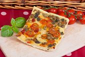 pic of nic  - Typical italian focaccia bread with cherry tomatoes and capers - JPG