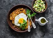 Pumpkin Rostis With Fried Egg And Avocado Salsa On Dark Background, Top View. Delicious Breakfast, S poster