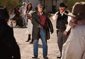 pic of gunfights  - Angry male and female gunfighters pull out their weapons - JPG