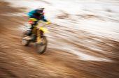 Motocross bike rider in motion