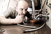 plumber thinking how to fix