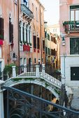 View Of The Canals And Buildings Of Venice. Beautiful Historic Brick Buildings On The Narrow Streets poster