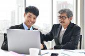 Senior And Junior Businessman Discuss Something During Their Meeting, Asian Businessman, Business Co poster
