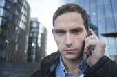 Serious Morose Moody Guy, Businessman Talking On His Cell Mobile Phone And Looking At Camera, Close  poster