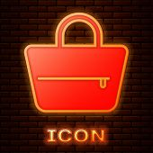Glowing Neon Handbag Icon Isolated On Brick Wall Background. Female Handbag Sign. Glamour Casual Bag poster