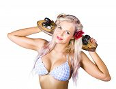 stock photo of bare midriff  - Glamorous blond woman with rose in her hair holding skateboard behind her head on white background - JPG