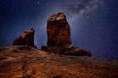 Gran canaria roque nublo in night stars light photo mount [ photo-illustration]