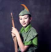 stock photo of fletching  - Young bow with wooden bow in Robin Hood costume - JPG