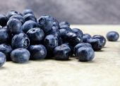 fresh ripe blueberries on tan kitchen counter top
