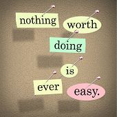 The quote or saying words Nothing Worth Doing is Ever Easy in pieces of paper pinned to a bulletin b