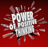 The words Power of Positive Thinking breaking through glass on a red background to symbolize reachin