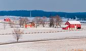 Red barns on snow covered battlefields, Gettysburg, PA.