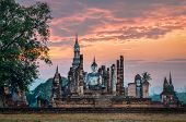 image of budha  - Sitting Budha at sunset in Wat Mahathat Sukhothai historical park Thailand - JPG