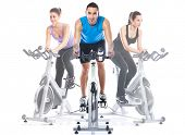 picture of cardio exercise  - Spinning training riding on  exercise bikes - JPG