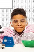 Black Little Boy Experiments With Chemistry