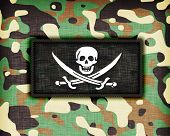 stock photo of ami  - Amy camouflage uniform with flag on it Pirate - JPG