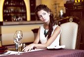 stock photo of expectations  - Luxury. Classy Romantic Woman in Restaurant. Expectancy
