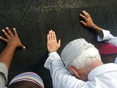 stock photo of obey  - Kaaba Mecca in Saudi Arabia and Muslim pilgrims coming for Hajj  - JPG
