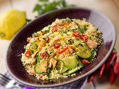 couscous with fresh salmon zucchinis and hot chili pepper, selective focus