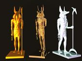 stock photo of embalming  - Three isolated statues of the Egyptian god Anubis - JPG
