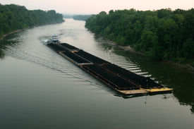 image of coal barge  - Large coal barge heading downriver on the Cumberland River Tennessee. ** Note: Slight blurriness, best at smaller sizes - JPG