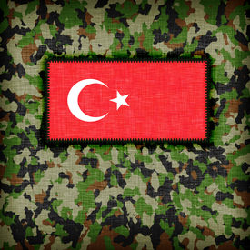 stock photo of ami  - Amy camouflage uniform with flag on it Turkey - JPG