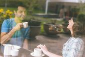 stock photo of canteen  - Two students laughing having a cup of coffee in college canteen - JPG