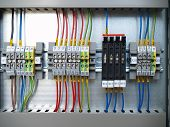 foto of contactor  - A part of cubicle with Distribution Rail terminal and relays - JPG