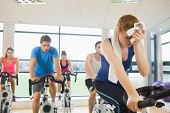 pic of exercise bike  - Determined and tired people working out at an exercise bike class in gym - JPG