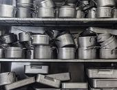 Shelf full of pans all in chrome