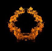 Circle of fire Blazing flames over black background