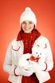 Portrait of happy girl in winterwear holding white teddy bear and looking at camera