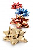 some gift ribbon bows of different colors on a white background