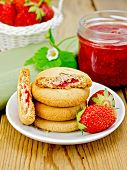 Biscuits With Strawberries And A Basket On The Board